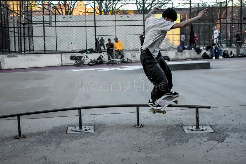 BROOKLYN, UNITED STATES - Apr 20, 2018: Skater. Practicing tricks in Brooklyn skate park stock image