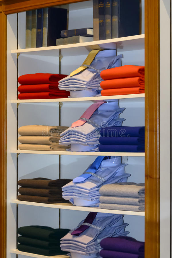 Brooks Brothers clothes. Full rack of men's clothes during the inauguration of the men's clothier Brooks Brothers flagship store in Madrid royalty free stock photo
