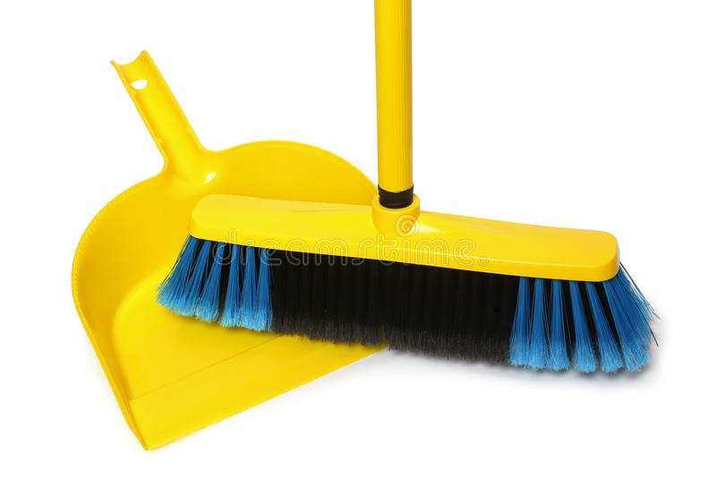 Broom and dustpan. On white background royalty free stock photos
