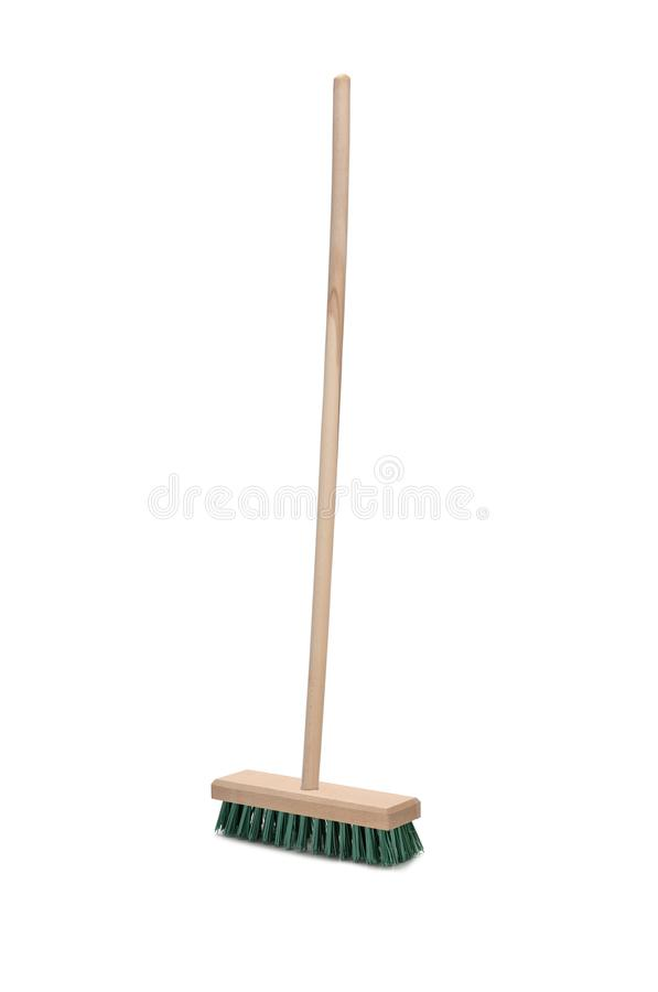 Broom with long handle isolated on white background. Broom with long wooden handle isolated on white background. Cleaning equipment for housework royalty free stock image