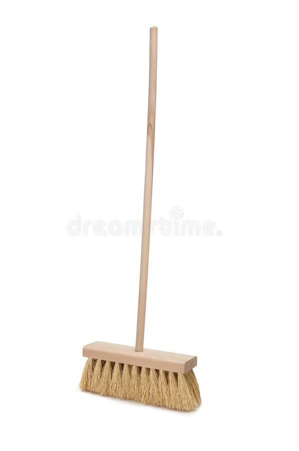 Broom with long handle isolated on white background. Broom with long wooden handle isolated on white background. Cleaning equipment for housework royalty free stock photos