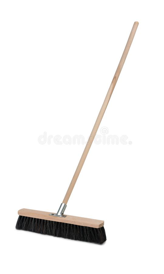 Broom with long handle isolated on white background. Broom with long wooden handle isolated on white background. Cleaning equipment for housework stock images