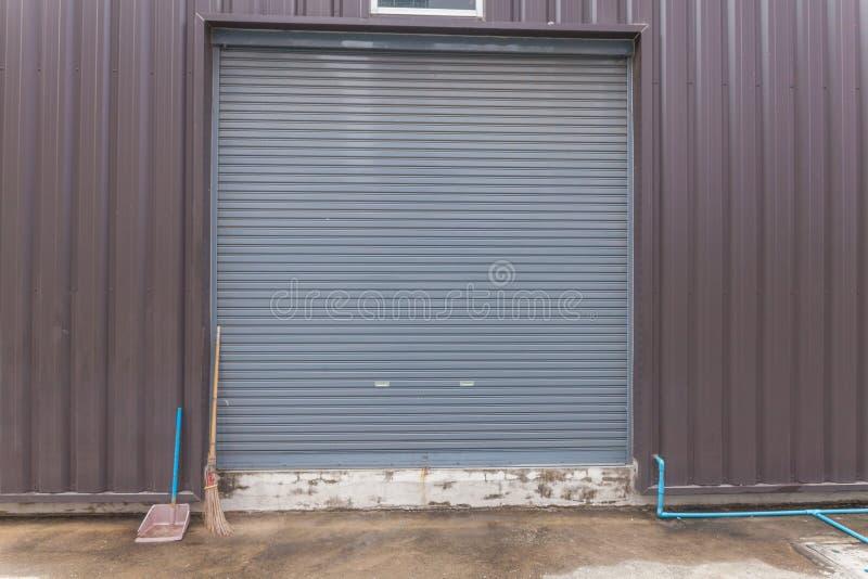Broom outside roller shutter door stock images