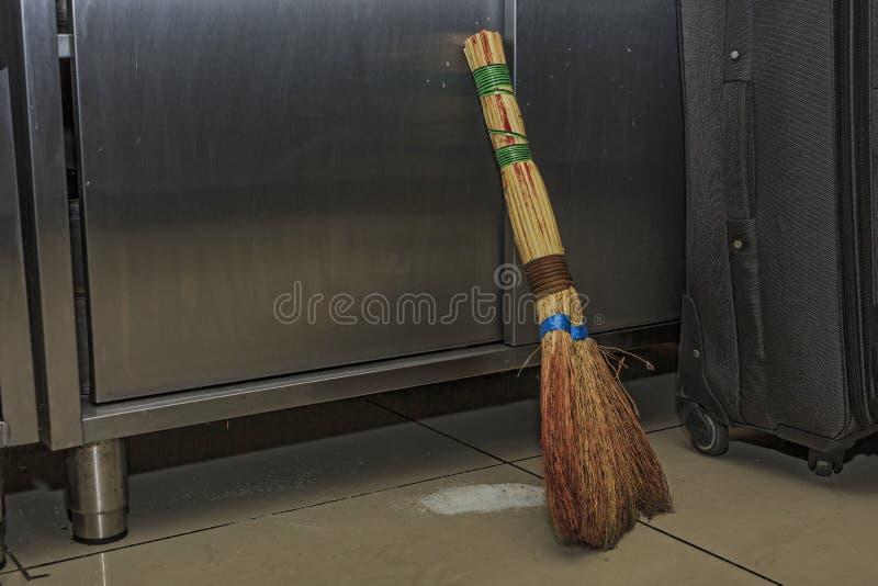 Dustpan, push broom, carlisle, broom head, duo sweep, floor cleaner, carpet floor, brush, cleaning. Broom sweeps garbage on the floor in the restaurant s kitchen stock images
