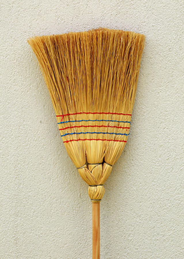 Broom. Whisk broom standing at wall stock image