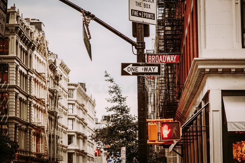 Broome and Broadway street crossing in SoHo District, New York City royalty free stock photo