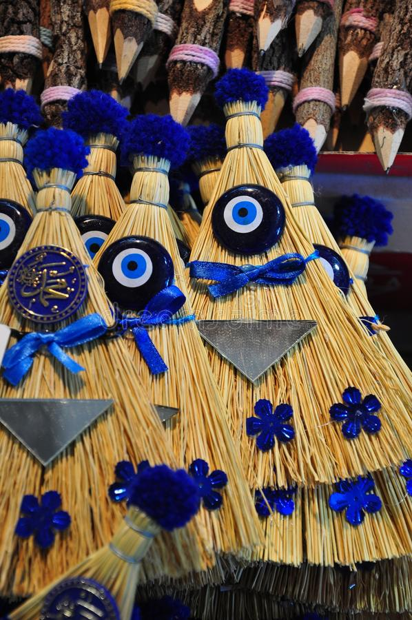 Brooms Decorated With Evil Eyes Stock Photo