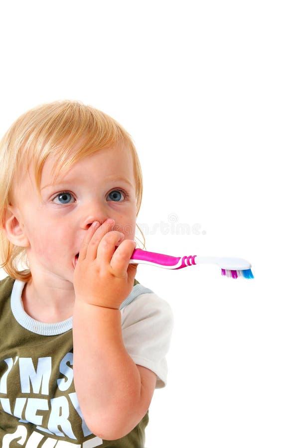 Brosse à dents d'enfant images stock