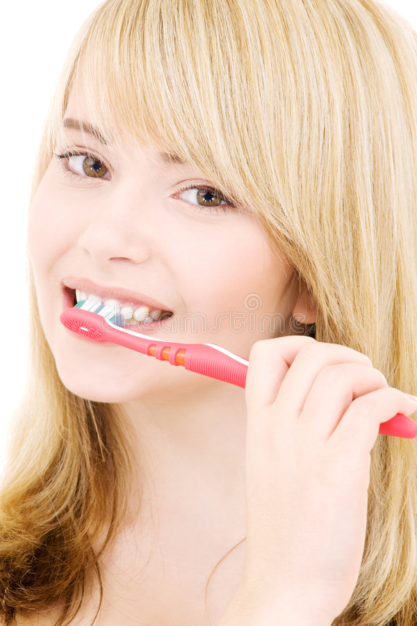 brosse à dents heureuse de fille photo libre de droits