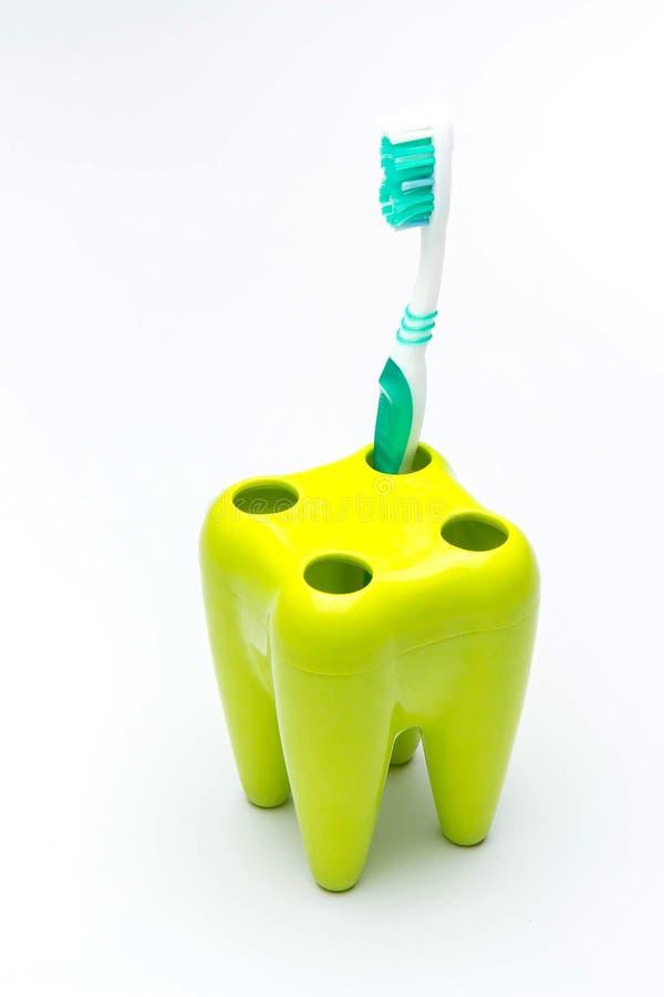 Brosse à dents sur le mode de plastique de dent image libre de droits