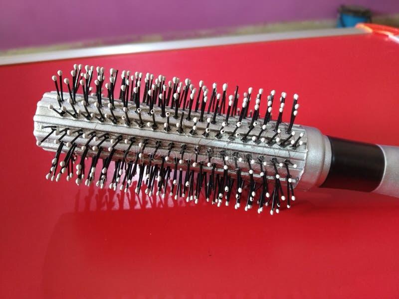 brosse de cheveux de styles de salons images stock