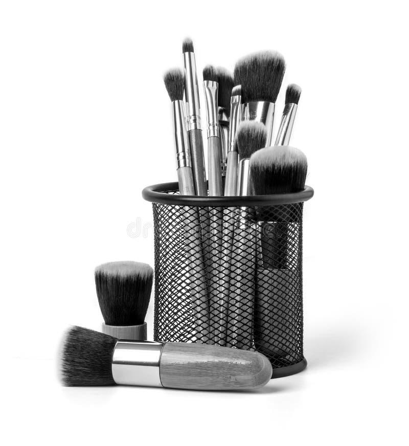 Brosse de lecture de maquillage photographie stock