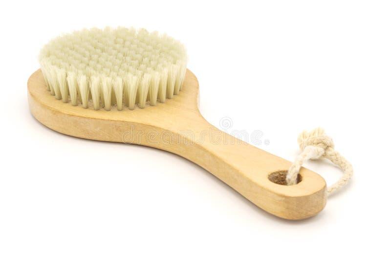 Brosse de massage avec les poils naturels ?pluchage de corps image libre de droits