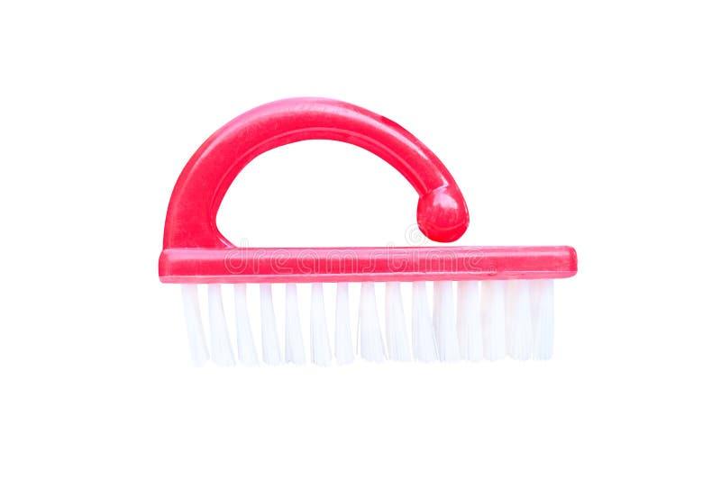 Brosse en plastique rouge de clou avec les poils blancs d'isolement sur le fond blanc avec le chemin de coupure photo stock