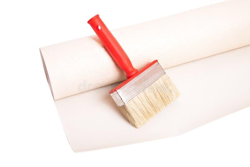 Brosse et rouleau de papier peint photo stock