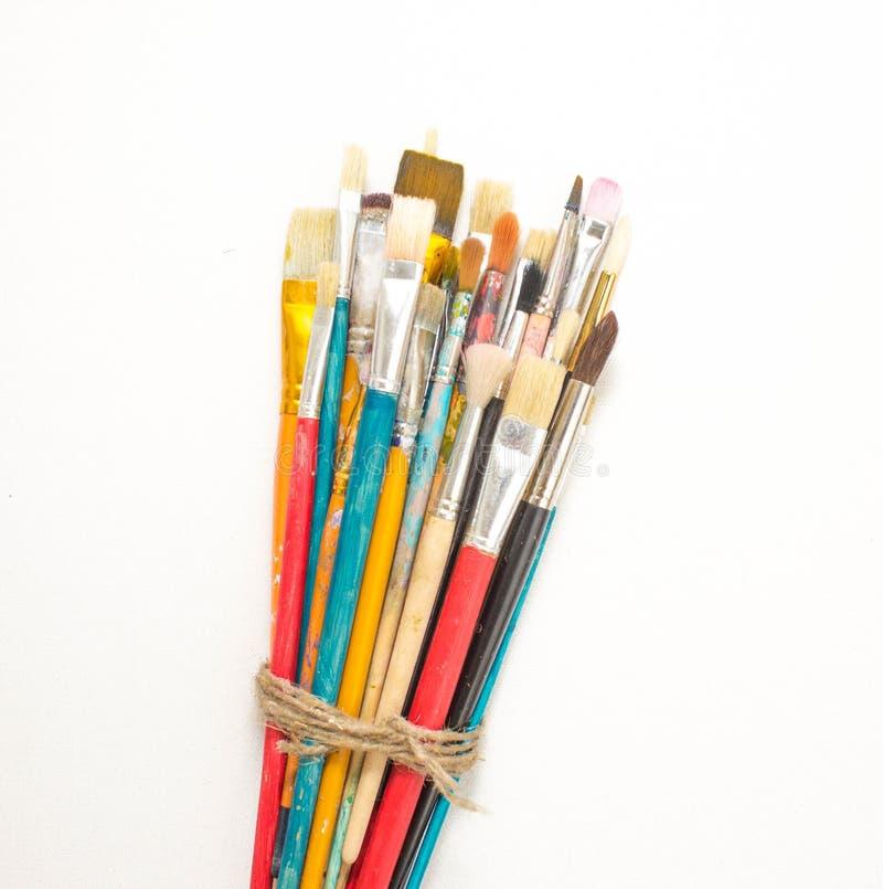 Brosse sur une toile blanche images libres de droits