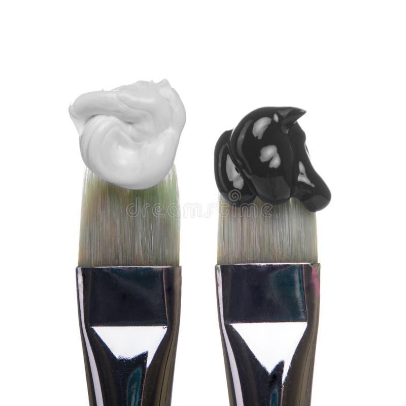 Brosses noires et blanches images stock