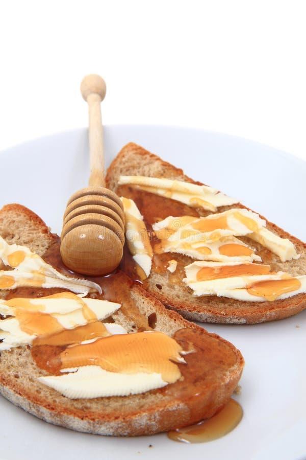Brot, Butter und frischer Honig stockbild