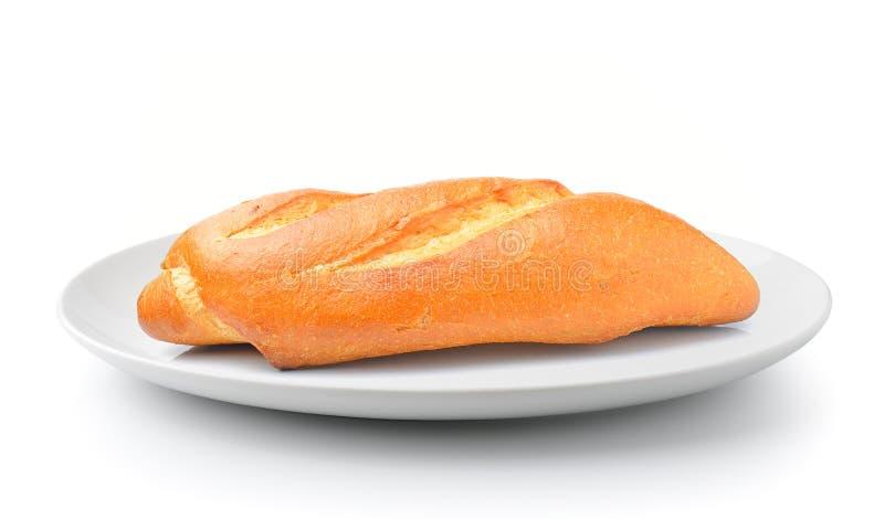 Brot in einer Platte lokalisiert auf weißem Hintergrund stockbilder