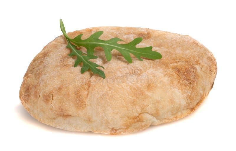 Brot mit Arugula auf weißem Hintergrund stockfoto
