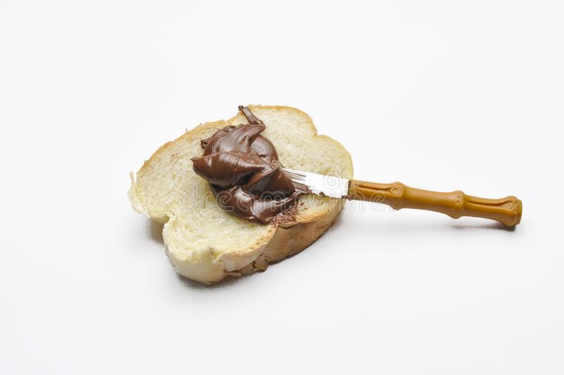 Brot mit Schokoladennougatcreme Fr?hst?ck lizenzfreie stockbilder