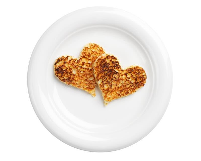 Brot mit zwei Toast in Form der Herzen stockbild