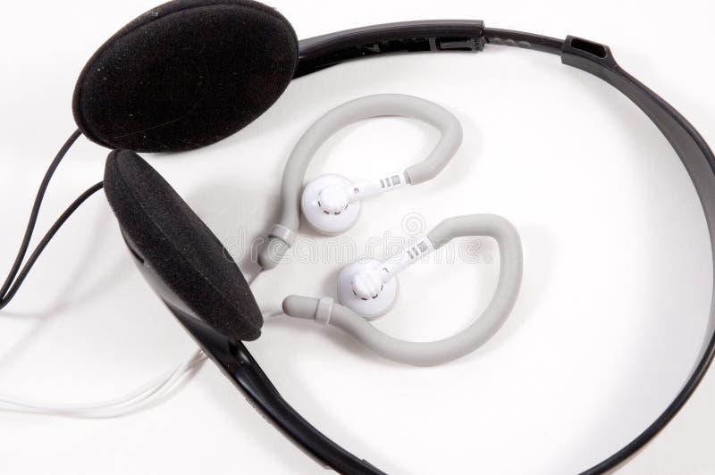 Brotes del oído con los auriculares fotografía de archivo libre de regalías