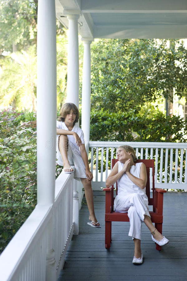 Free Brother And Sister Relaxing On Porch Royalty Free Stock Photography - 11024847
