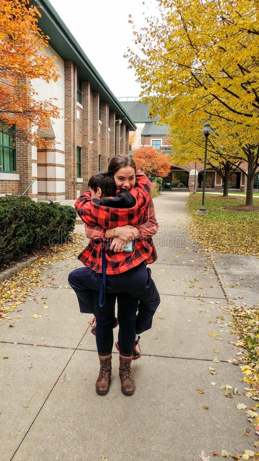 Giant Hug, Brother, Sister, College royalty free stock photography