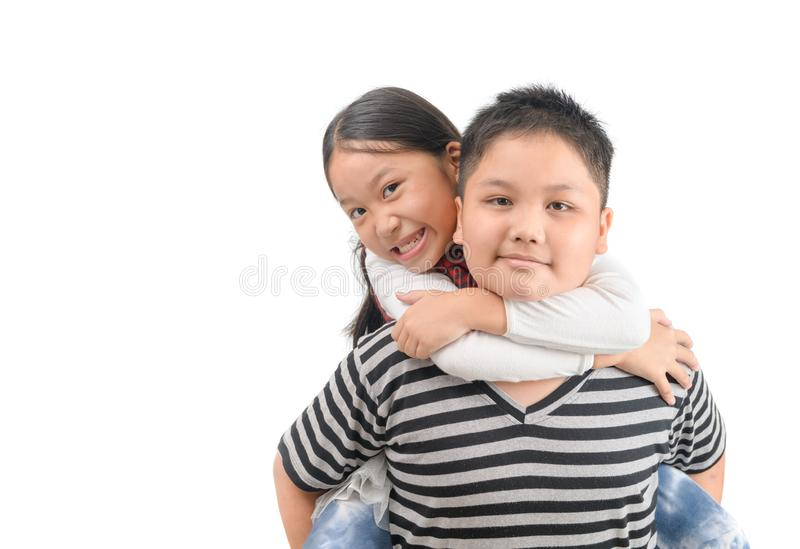 Brother giving piggyback ride to sister isolated on white stock images