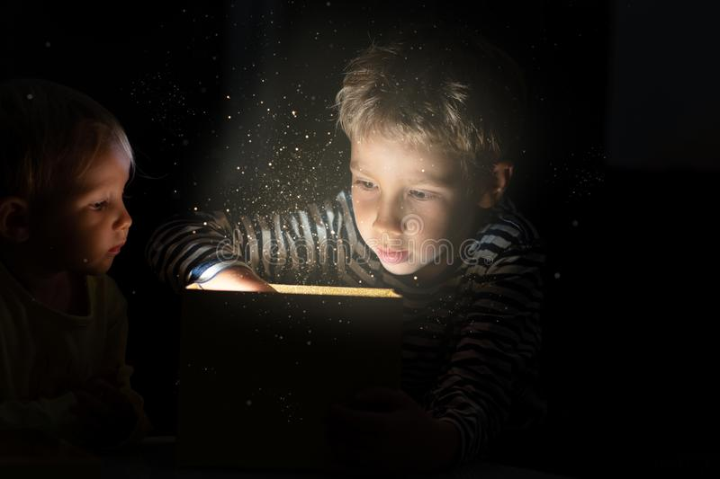 Brother and his little sister with christmas gift box stock photography