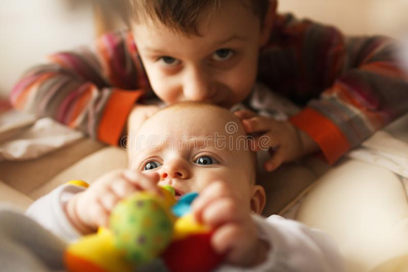 Brother with his little sister. royalty free stock image