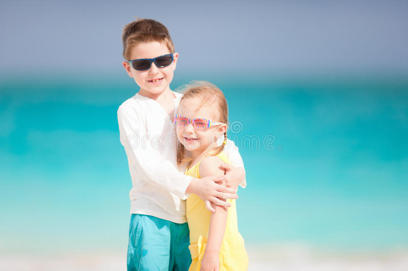 Brother And Sister On Beach Vacation Stock Photo
