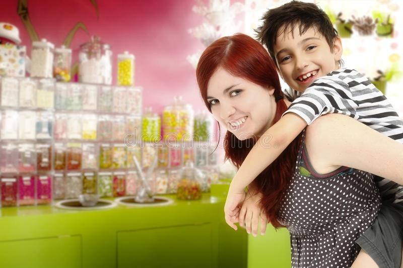 Brother and Sister at the Candy Store. Big sister or babysitter taking younger brother to the candy store stock photos