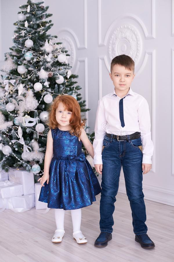 Brother and sister. Christmas interior. Family portrait. Small children. Brother and sister. Christmas interior. Family portrait. Small beautiful children stock photos