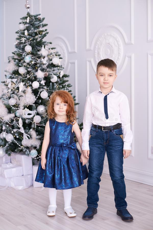 Brother and sister. Christmas interior. Family portrait. Small children. White background stock photos