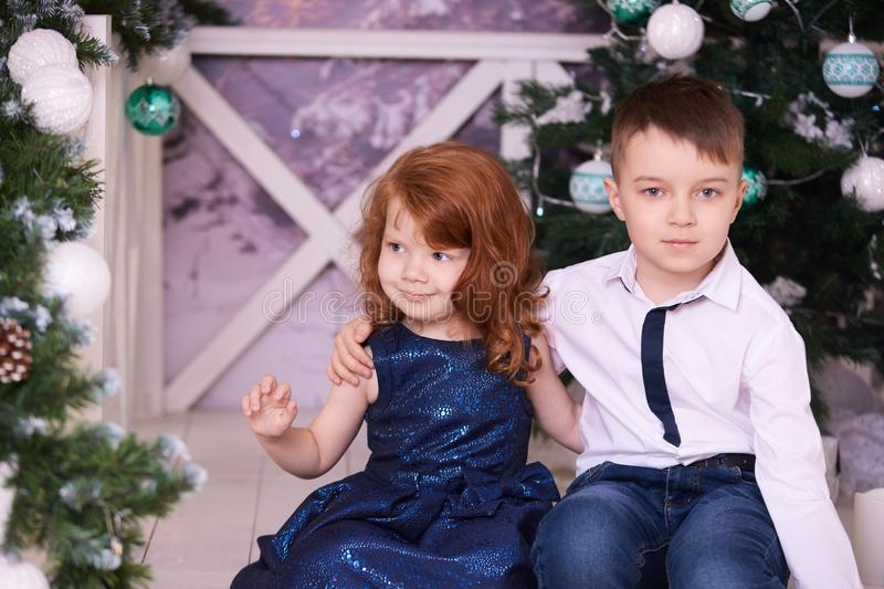 Brother and sister. Christmas interior. Small children. Horizontal stock photos