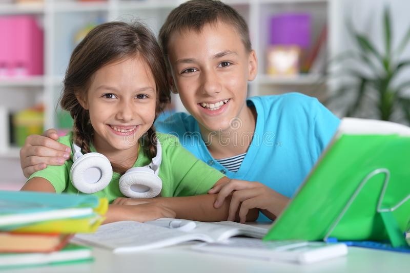 Portrait of brother and sister doing homework together stock images