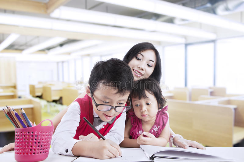 Download Brother And Sister Drawing In Class Stock Image - Image: 28162097