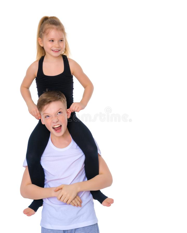 Brother and sister embrace. stock images