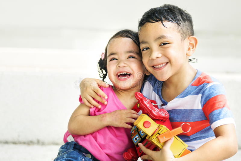 Brother Sister Girl Boy Kid Joy Playful Leisure Concept. Little Brother and Sister Playing Concept royalty free stock photo