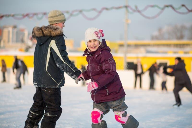 Brother and sister having fun skating royalty free stock photos