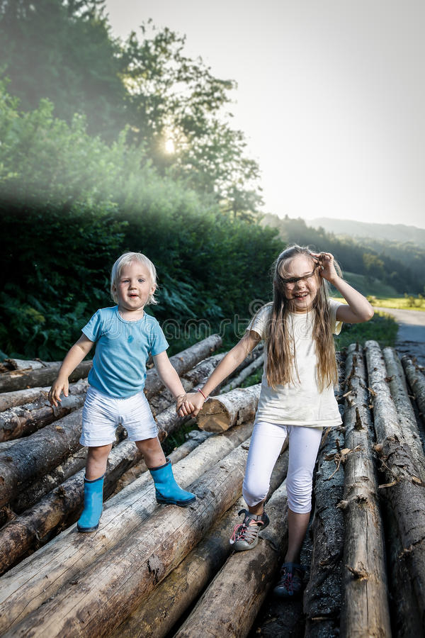Brother and sister holding hands, walking in nature stock photos