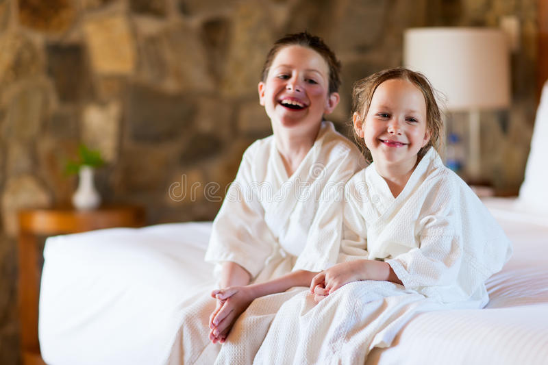 Brother and sister at hotel room royalty free stock photo