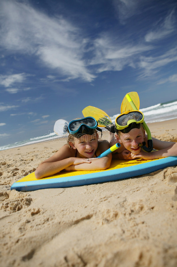 Download Brother And Sister Lying On The Sand Stock Photography - Image: 9001072