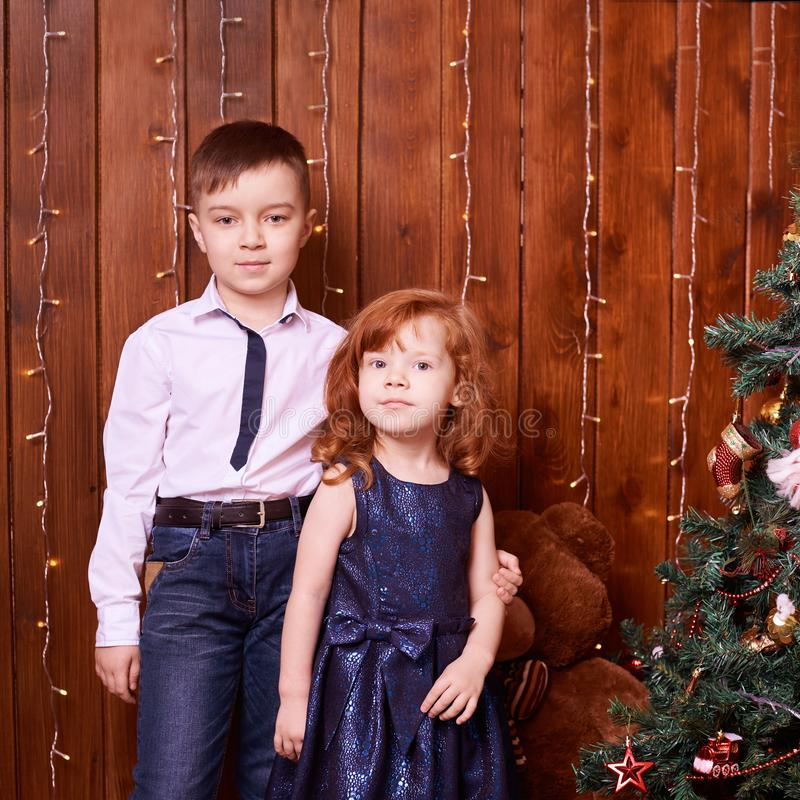 Brother and sister. New Year xmas child. Christmas eve holiday. interior. Small children. Family portrait stock photography