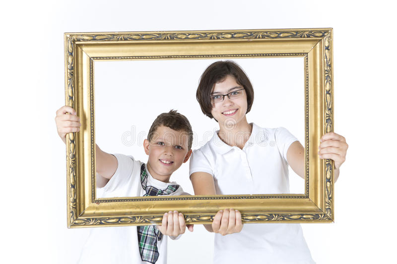 Brother And Sister With Picture Frame In Front Of Them Stock Image ...