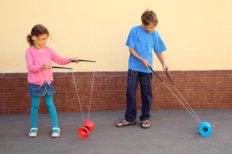 Download Brother And Sister Play With Yo-yo Toy Royalty Free Stock Images - Image: 26337909