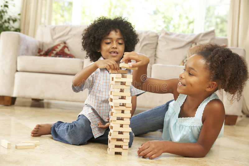 Download Brother And Sister Playing Game At Home Stock Photo - Image: 11502340