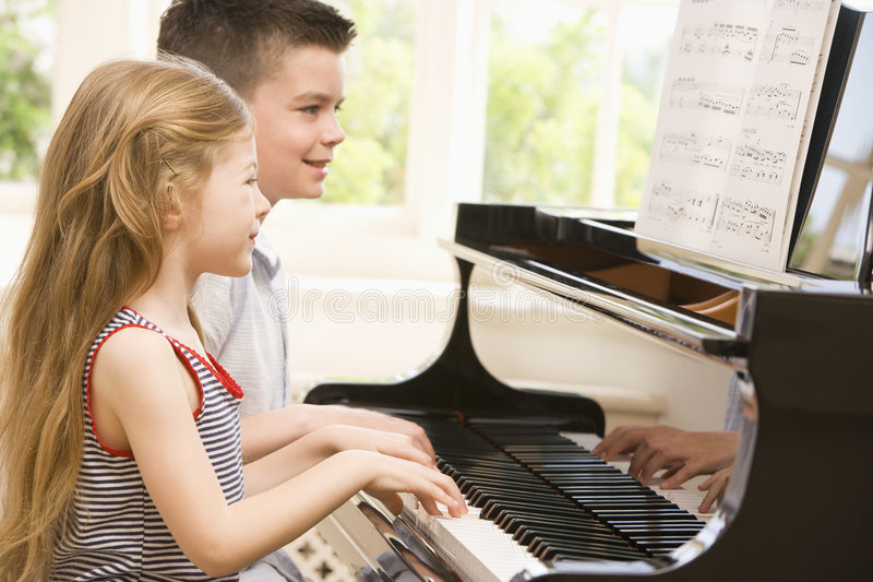 Brother And Sister Playing Piano Royalty Free Stock Photo